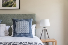 Garden-Haven-Rm2-close-up-of-half-bed-and-side-table-with-lamp-dog-friendly-credit-Mike-Searle