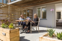 Garden-Haven-courtyard-with-friends-enjoying-the-sunshine-a-glass-of-wine-dog-friendly-credit-Mike-Searle